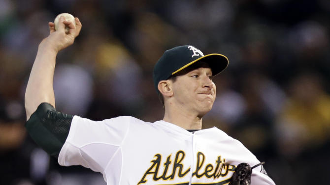 Oakland Athletics pitcher Jarrod Parker delivers a pitch in the first inning of Game 5 of an American League division baseball series against the Detroit Tigers in Oakland, Calif., Thursday, Oct. 11, 2012.   (AP Photo/Marcio Jose Sanchez)