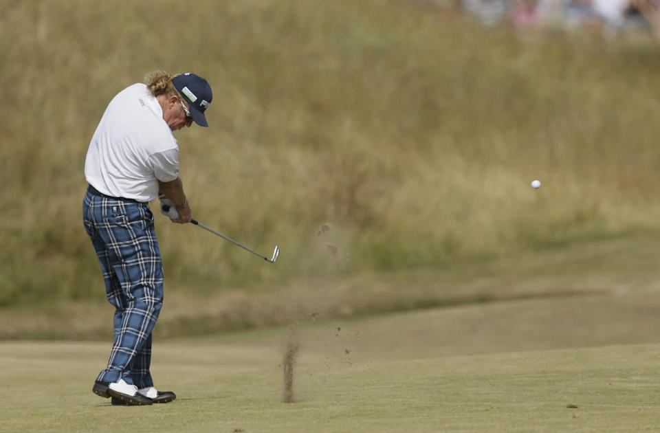 Miguel Angel Jimenez of Spain plays a shot on the third fairway during the third round of the British Open Golf Championship at Muirfield, Scotland, Saturday July 20, 2013. (AP Photo/Jon Super)