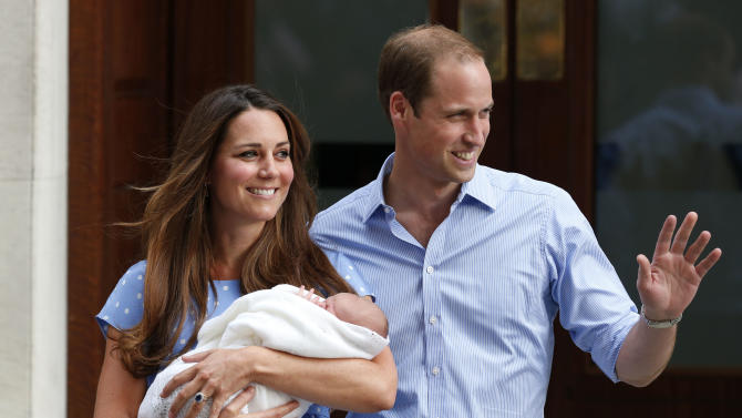 Britain's Prince William and Kate, Duchess of Cambridge hold the Prince of Cambridge, Tuesday July 23, 2013, as they pose for photographers outside St. Mary's Hospital exclusive Lindo Wing in London where the Duchess gave birth on Monday July 22. The Royal couple are expected to head to London's Kensington Palace from the hospital with their newly born son, the third in line to the British throne. (AP Photo/Lefteris Pitarakis)