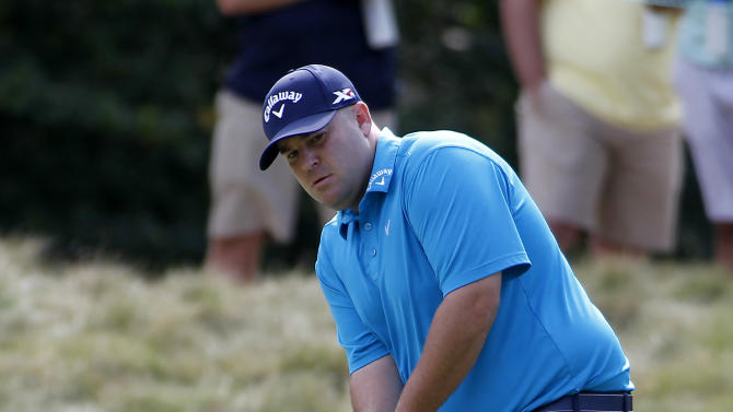 Colt Knost putts on the ninth hole during the first round of the Deutsche Bank Championship golf tournament in Norton, Mass., Friday, Sept. 4, 2015. (AP Photo/Stew Milne)