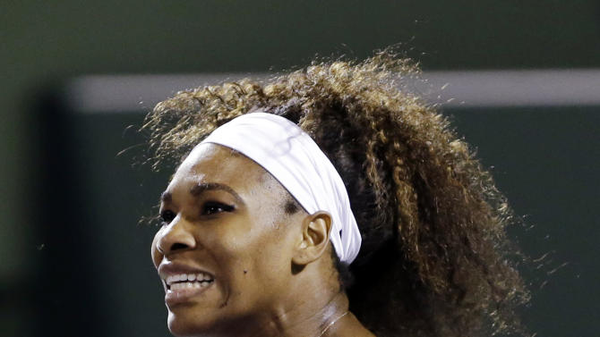 Serena Williams celebrates winning a point against Agnieszka Radwanska, of Poland, during a semifinal match in the Sony Open tennis tournament, Thursday, March 28, 2013, in Key Biscayne, Fla. Williams won 6-0, 6-3. (AP Photo/Wilfredo Lee)