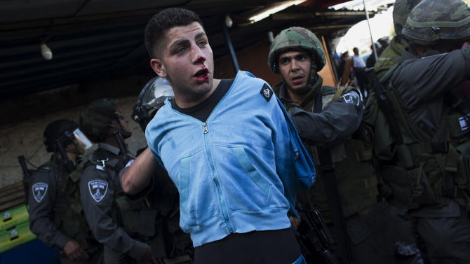"Israeli security forces detain a Palestinian man during clashes that erupted during a rally marking Nakba Day in Jerusalem, Wednesday, May 15, 2013. Palestinians annually mark the ""nakba,"" or ""catastrophe"" — the term they use to describe their defeat and displacement in the war that followed Israel's founding in 1948. (AP Photo/Bernat Armangue)"