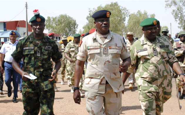 Maj. Gen. Kenneth Osuji, commander Nigeria Army peace keeping centre, left, Maj. Gen. John Zaruwa, commander Nigeria peace keeping centre, Lt.  Gen. Onyeabo Azubike Ihejirika, Nigeria chief of army st