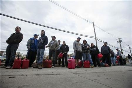 People affected by the power outages from Hurricane Sandy wait in a 2hr line at a gas station to purchase fuel for generators in Madison Park, New Jersey