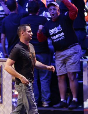 Andras Koroknai, of Debrecen, Hungary, walks off the stage after being eliminated from play during the World Series of Poker Final Table event, Monday, Oct. 29, 2012, in Las Vegas. (AP Photo/Julie Jacobson)
