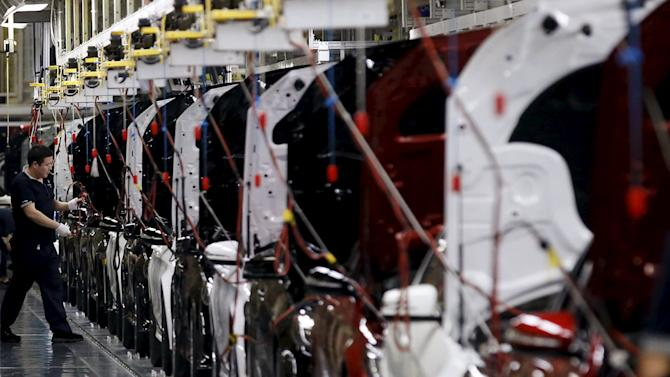 Employee works on an assembly line producing Mercedes-Benz cars at a factory of Beijing Benz Automotive Co.in Beijing