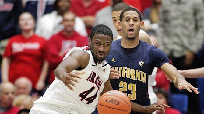 Arizona's Solomon Hill (44) and California's Allen Crabbe (23) struggle for control of a loose ball during the second half of an NCAA college basketball game at McKale Center in Tucson, Ariz.,Sunday, Feb. 10, 2013. California won 77-69. (AP Photo/John Miller)