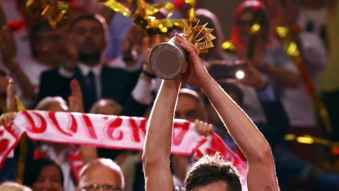 Poland's team captain Winiarski holds the trophy after defeating Brazil to win the Volleyball Men's World Championship final at Spodek Arena in Katowice