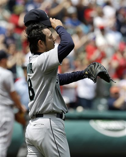 Seattle Mariners starting pitcher Hisashi Iwakuma reacts as he waits for Cleveland Indians' Ryan Raburn to run the bases after Raburn hit a three-run home run in the second inning of a baseball game, 