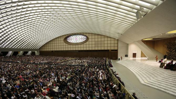 """Pope Benedict XVI leads his weekly general audience at the Paul VI Hall at the Vatican, Wednesday Feb. 13, 2013. Looking tired but serene, Pope Benedict XVI told thousands of faithful Wednesday that he was stepping down for """"the good of the church,"""" speaking in his first public appearance since dropping the bombshell announcement of his resignation. The 85-year-old Benedict basked in more than a minute-long standing ovation when he entered the packed audience hall for his traditional Wednesday general audience. He was interrupted by applause by the thousands of people, many of whom had tears in their eyes. (AP Photo/Alessandra Tarantino)"""