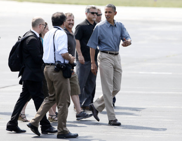 President Obama walks on the tarmac after arriving on Air Force One at Toledo Express Airport in Swanton, Ohio, Thursday July 5, 2012, for the start of his bus tour. (AP Photo/Madalyn Ruggiero)