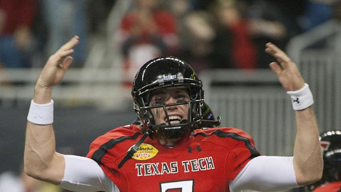 Texas Tech's Seth Doege gestures after scoring a touchdown against Minnesota during the second quarter of the Meineke Car Care Bowl NCAA college football game, Friday, Dec. 28, 2012, in Houston. (AP Photo/Dave Einsel)