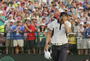 Martin Kaymer, of Germany rects after winning the U.S.…