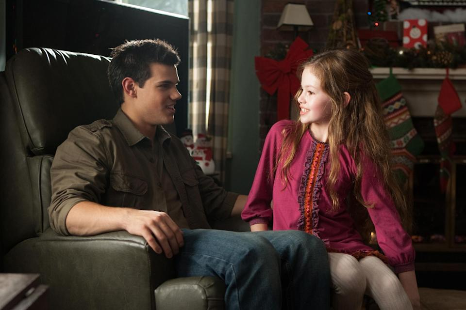 "This film image released by Summit Entertainment shows Taylor Lautner, left, and Mackenzie Foy in a scene from ""The Twilight Saga: Breaking Dawn Part 2."" (AP Photo/Summit Entertainment, Andrew Cooper)  Ph: Andrew Cooper, SMPSP © 2011 Summit Entertainment, LLC.  All rights reserved."
