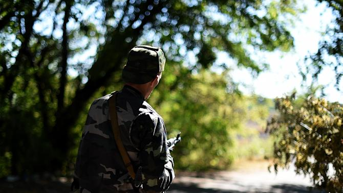 A Pro-Russian fighter stands on September 2, 2014 on a road to Donetsk airport