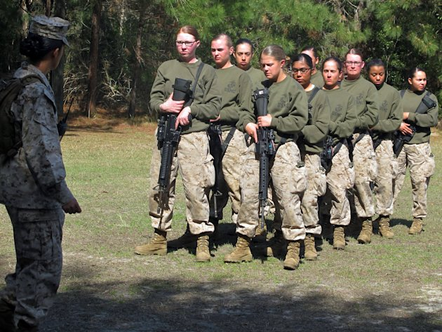 In this Feb. 21, 2013 photo, female recruits form up at the Marine Corps Training Depot on Parris Island, S.C. Brig Gen. Loretta Reynolds, the first female general in charge of Parris Island's bas
