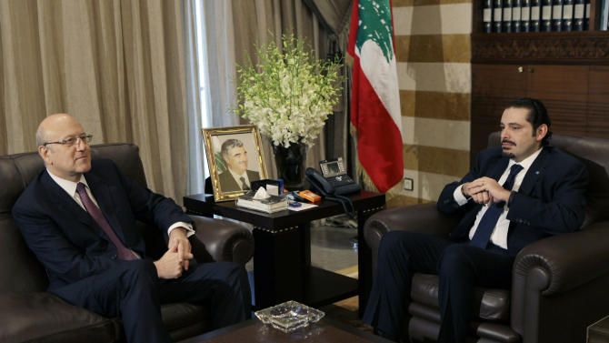 Lebanon's caretaker Prime Minister Saad Hariri, right, meets with Prime Minister-designate Najib Mikati, left, at Hariri's residence in Beirut, Lebanon, Wednesday, Jan. 26, 2011. Lebanon's new Hezbollah-backed prime minister began the process of forming a new Cabinet on Wednesday, as calm returned to the country after two days of protests against the Iranian-backed militant group's growing influence. (AP Photo/Hussein Malla)