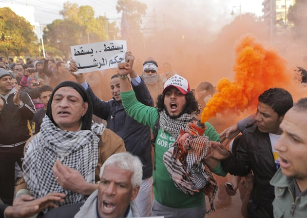 Egyptians shout slogans during anti-President Mohammed Morsi protest in front of the presidential palace in Cairo, Egypt, Friday, Feb. 1, 2013. Thousands of Egyptians marched across the country, chant