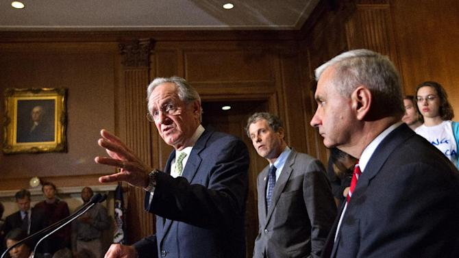From left, Sen. Tom Harkin, D-Iowa, Sen. Sherrod Brown, D-Ohio, and Sen. Jack Reed, D-R.I., are backed up by students during a news conference on Capitol Hill in Washington, Tuesday, May 8, 2012, as the Senate moved toward a showdown on a Democratic proposal to keep federally subsidized loan interest rates from doubling for millions of college students.  (AP Photo/J. Scott Applewhite)