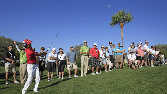 Ryo Ishikawa, of Japan, hits a shot from the rough to the 15th green during the first round of the Arnold Palmer Invitational golf tournament at Bay Hill, Thursday, March 22, 2012, in Orlando, Fla. (AP Photo/John Raoux)