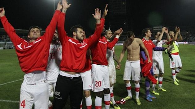 Switzerland's players celebrate after they beat Albania during their 2014 World Cup qualifying (Reuters)