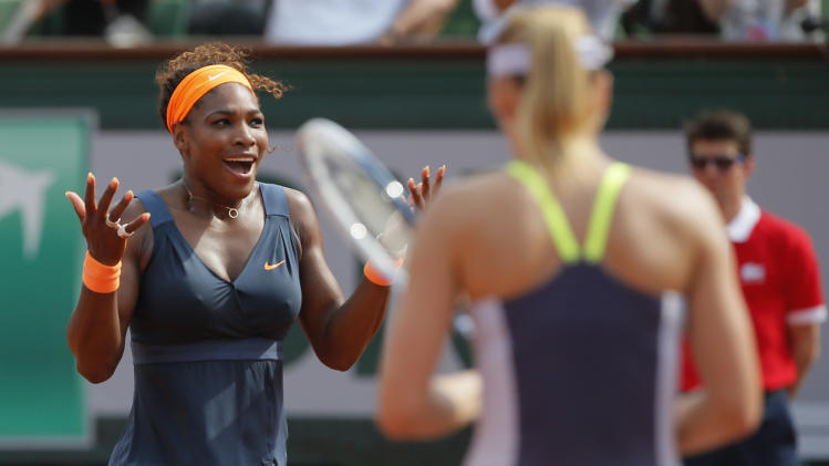 Serena Williams of the U.S., left, celebrates winning against Russia's Maria Sharapova, center, in two sets 6-4, 6-4, in the women's final of the French Open tennis tournament, at Roland Garros stadium in Paris, Saturday June 8, 2013. (AP Photo/Michel Spingler)