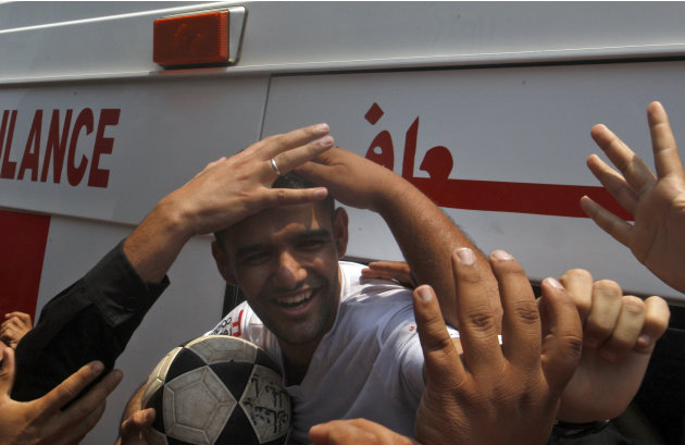 Palestinian Mahmoud Sarsak, a former player with the Palestinian national football team arrives at al-Shifa hospital in Gaza City, after his release from Israeli prison where he was held for three yea