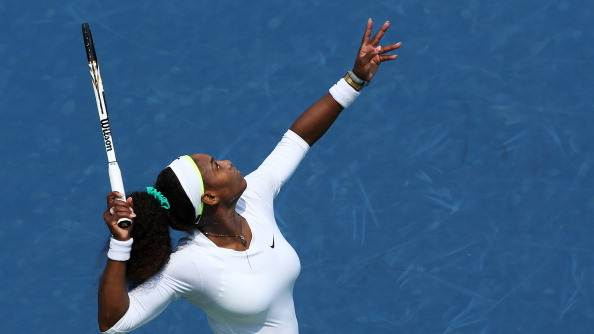 Serena Williams serves against Urszula Radwanska of Poland during day six of the Western & Southern Open at Lindner Family Tennis Center on August 16, 2012 in Mason, Ohio. (Photo by Nick Laham/Getty Images)