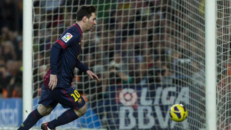 FC Barcelona's Lionel Messi, from Argentina, scores his second goal against Atletico Madrid during a Spanish La Liga soccer match at the Camp Nou stadium in Barcelona, Spain, Sunday, Dec. 16, 2012, (AP Photo/Bernat Armangue)