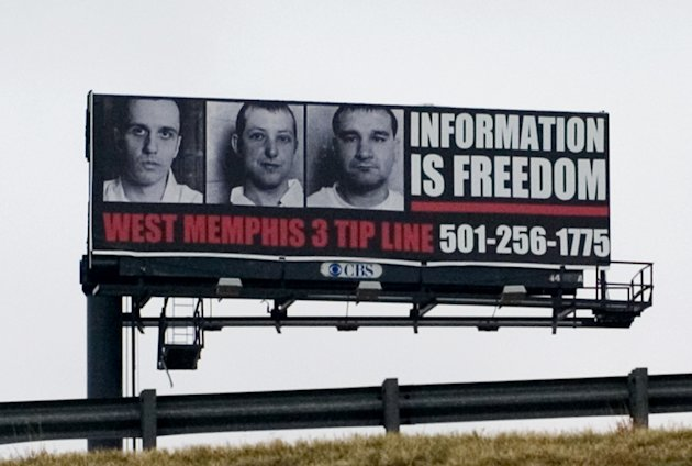 "This undated publicity photo released by Sony Pictures Classics shows a billboard for the West Memphis 3 tip line from the documentary film, ""West of Memphis."" (AP Photo/Sony Pictures Classics, Olivia Fougeirol)"