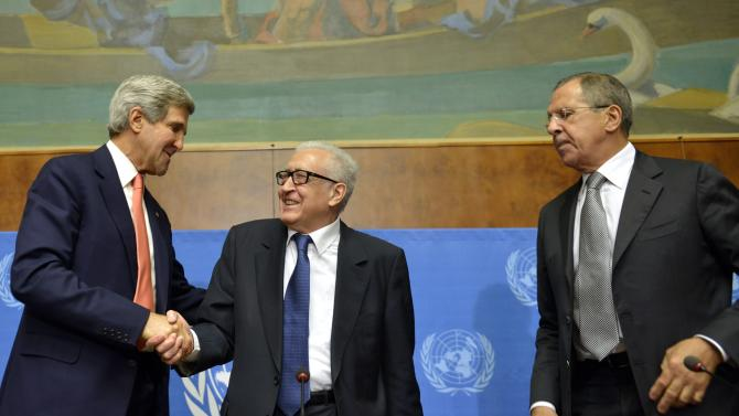 """John Kerry, left, US Secretary of State, shakes hands with Lakhdar Brahimi, center, UN Joint Special Representative for Syria, next to Sergei Lavrov, right, Russian Foreign Minister during a press conference after their meeting at the European headquarters of the United Nations in Geneva, Switzerland, Friday, Sept. 13, 2013. Kerry and Lavrov say the prospects for a resumption in the Syria peace process are riding on the outcome of their chemical weapons talks. Kerry, flanked by Lavrov and Brahimi, told reporters after an hour-long meeting that the chances for a second peace conference in Geneva """"will obviously depend on the capacity to have success here ... on the subject of the chemical weapons."""" (AP Photo/Keystone, Martial Trezzini)"""