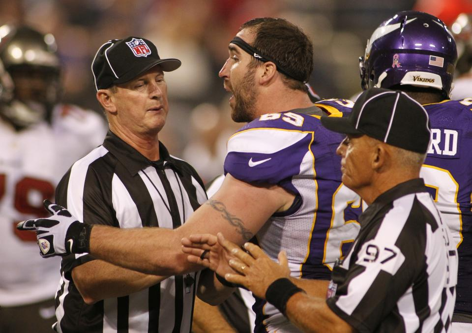 Minnesota Vikings defensive end Jared Allen argues with officials after getting in a tussle with Tampa Bay Buccaneers tackle Donald Penn during the second half of an NFL football game Thursday, Oct. 25, 2012, in Minneapolis. (AP Photo/Andy King)