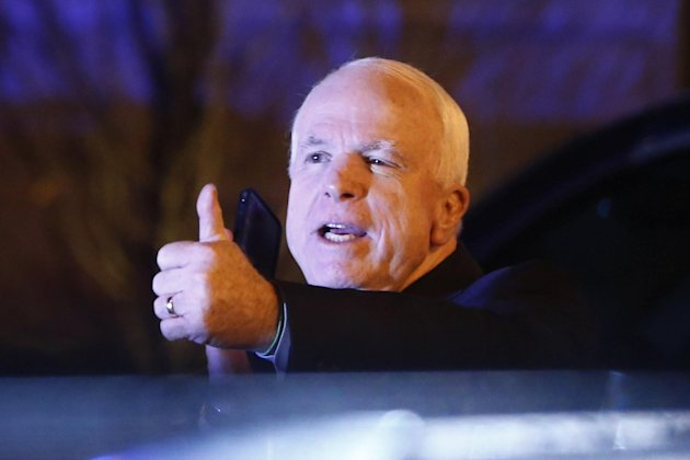 Sen. John McCain, R-Ariz., gives a thumbs up as he emerges from a private dinner with President Barack Obama and Republican senators at the Jefferson Hotel in Washington, Wednesday, March 6, 2013. (AP Photo/Charles Dharapak)