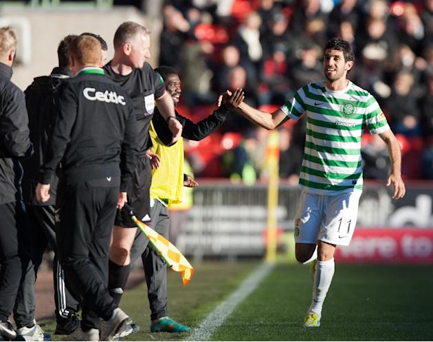 Lassad Nouioui, right, has been hailed by Celtic boss Neil Lennon