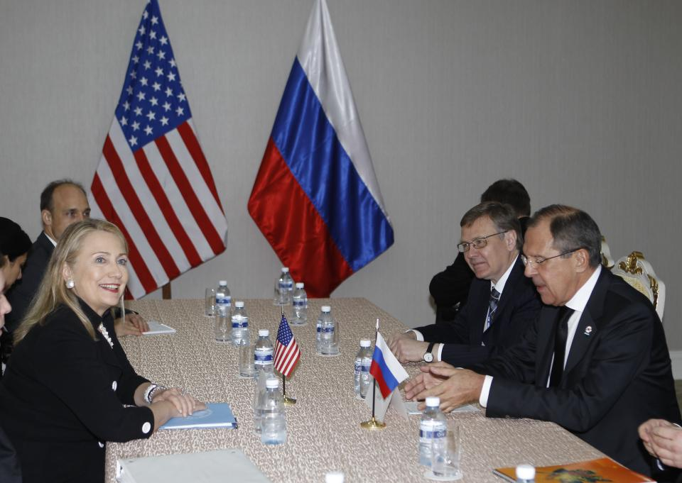 U.S. Secretary of State Hillary Rodham Clinton, left, holds a bilateral meeting with Russian Foreign Minister Sergey Lavrov during the East Asia Summit in Phnom Penh, Cambodia, Tuesday, Nov. 20, 2012. (AP Photo/Vincent Thian)