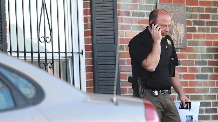 In this Nov. 2, 2012 photo, DeKalb police Sgt. Jason Leverton speaks on the phone outside of the Pi Kappa Alpha house in DeKalb, Ill. where police were investigating the death of NIU freshman David Bogenberger. Nearly two dozen Pi Kappa Alpha members at Northern Illinois University have been charged with hazing-related counts after Bogenberger was found dead at their fraternity house following a night of drinking. (AP Photo/Daily Chronicle, Kyle Bursaw) CHICAGO LOCALS OUT; ROCKFORD REGISTER STAR OUT; MANDATORY CREDIT
