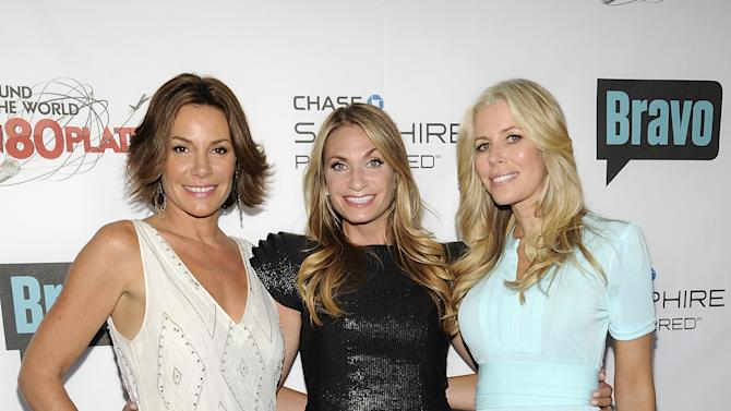 """COMMERCIAL IMAGE - Television personalities LuAnn de Lesseps, left, Heather Thomson and Aviva Drescher, right, attend the """"Around the World in 80 Plates"""" Finale Sneak Peek Party presented by Chase Sapphire Preferred and Bravo on Thursday, July 12, 2012 in New York,. (Photo by Evan Agostini/Invision for Chase Sapphire Preferred/AP Images)"""