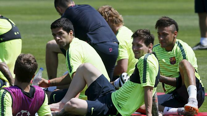 Barcelona's players Gerard Pique, Luis Suarez, Lionel Messi and Neymar attend a training session June 2, 2015, during the media Barcelona Open Day