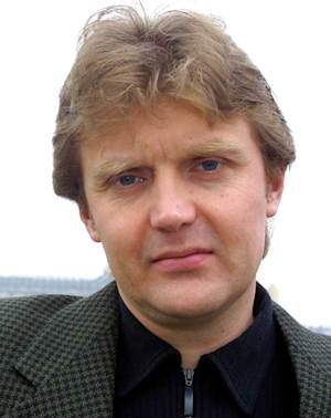 """FILE -  In this May 10, 2002 file photo, Alexander Litvinenko, Kremlin critic and author of the book """"Blowing Up Russia: Terror From Within"""", poses for a photograph at his home in London. An inquest into the death of former Russian agent Alexander Litvinenko should take place early next year and will likely consider whether Russian authorities were involved, a senior British judge said Thursday, Sept. 20, 2012. (AP Photo/Alistair Fuller, File)"""