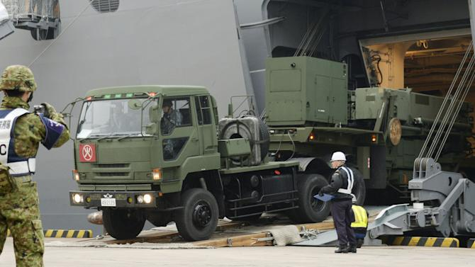 A vehicle carrying a PAC-3 missile interceptor arrives at a port on Ishigaki Island, Okinawa prefecture, southwestern Japan Saturday, Feb. 6, 2016. North Korea has moved up the window of its planned long-range rocket launch to Feb. 7-14, South Korea's Defense Ministry said Saturday. The launch, which the North says is an effort to send a satellite into orbit, would be in defiance of repeated warnings by outside governments who suspect it is a banned test of ballistic missile technology. (Koji Harada/Kyodo News via AP) JAPAN OUT, MANDATORY CREDIT