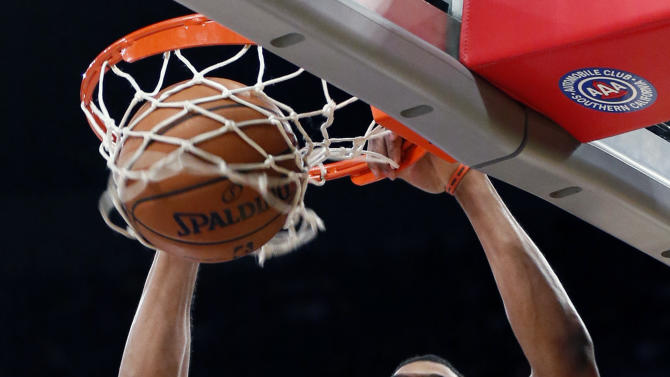 Phoenix Suns' Markieff Morris dunks the ball against the Los Angeles Lakers during the first half of an NBA basketball game on Tuesday, Feb. 12, 2013, in Los Angeles. (AP Photo/Danny Moloshok)