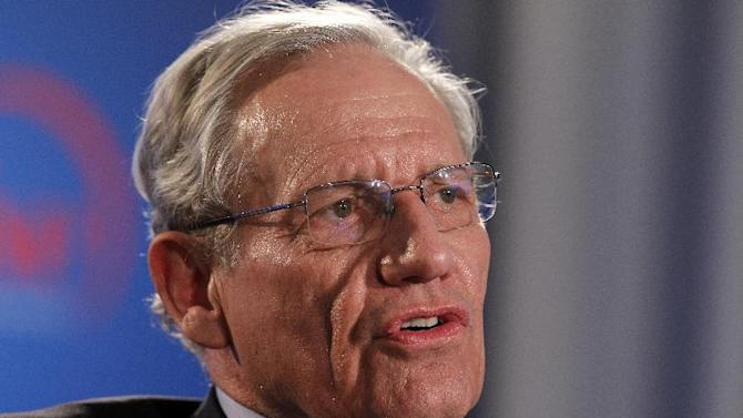 """FILE - This June 11, 2012 file photo shows former Washington Post reporter Bob Woodward speaking during an event to commemorate the 40th anniversary of Watergate in Washington. The next book by the award-winning investigative reporter and best-selling author will document how President Barack Obama and congressional leaders responded to the economic crisis and where we stand now. Publisher Simon & Schuster announced Tuesday, Aug. 14, the book will be called """"The Price of Politics"""" and will come out Sept. 11. (AP Photo/Alex Brandon, file)"""