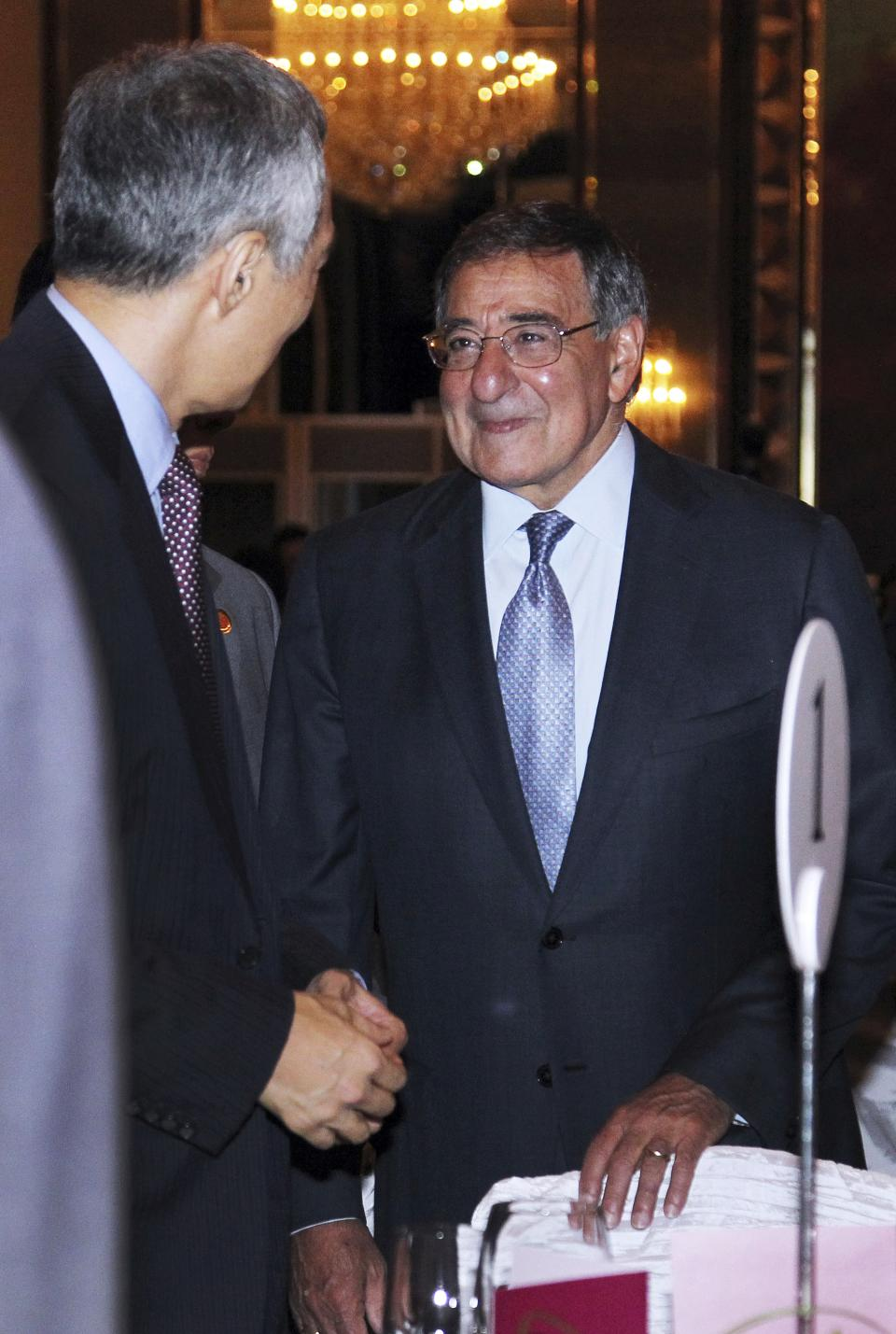 U.S. Defense Secretary Leon Panetta, right, speaks to Singapore's Prime Minister Lee Hsien Loong, left, at the opening session of the IISS Shangri-la Security Summit in Singapore on Friday June 1, 2012. (AP Photo/Wong Maye-E)