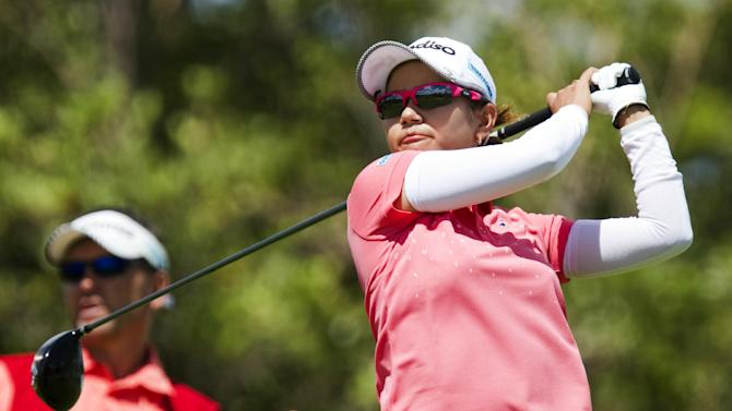 Ai Miyazato, of Japan, watches her drive of the second tee in the third round of the LPGA LOTTE Championship golf tournament at Ko Olina Golf Club Friday, April 20, 2012, in Kapolei, Hawaii. (AP Photo/Eugene Tanner)