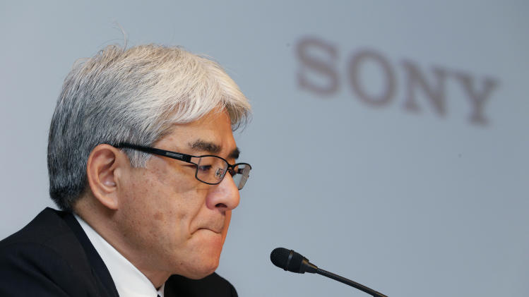 Sony Corp. Chief Financial Officer Masaru Kato bites his lips during a news conference at the company's head office in Tokyo, Thursday, May 10, 2012. Sony Corp. racked up a record annual loss of 457 billion yen ($5.7 billion) in its fourth straight year of red ink as the once-glorious maker of the Walkman and PlayStation struggles toward a turnaround under a new president. (AP Photo/Shizuo Kambayashi)