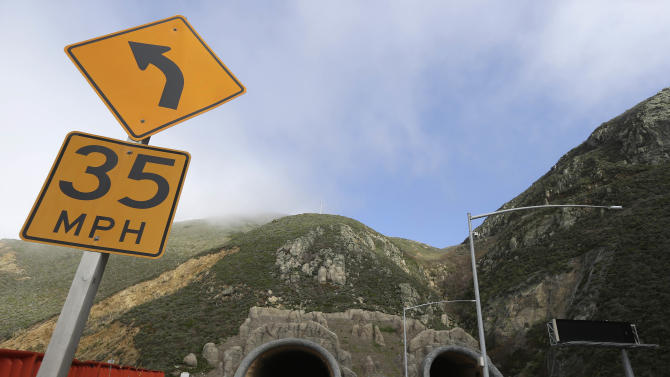 The southern portals of the Devil's Slide tunnel project in Pacifica, Calif. are seen in a Wednesday, Feb. 13, 2013 photo. It's been almost 50 years since California built a tunnel, but this month one of the largest engineering jobs in the U.S. today is expected to open, moving motorists from a stunning, cliffhanger of a drive to straight and well lit pair of 4,200-foot tunnels carved through the stony cliffs of the California coastline. The $439 million project, paid entirely by the federal government, features exhaust fans, carbon monoxide sensors, and a pair of 1,000 foot bridges which soar 125 feet above a grassy ranch. (AP Photo/Eric Risberg)