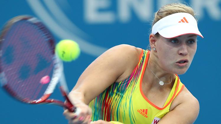 Angelique Kerber of Germany plays a shot in her 2nd round match against Monica Puig of Puerto Rico during the Brisbane International tennis tournament held in Brisbane, Australia, Wednesday, Jan 2, 2013.  (AP Photo/Tertius Pickard).