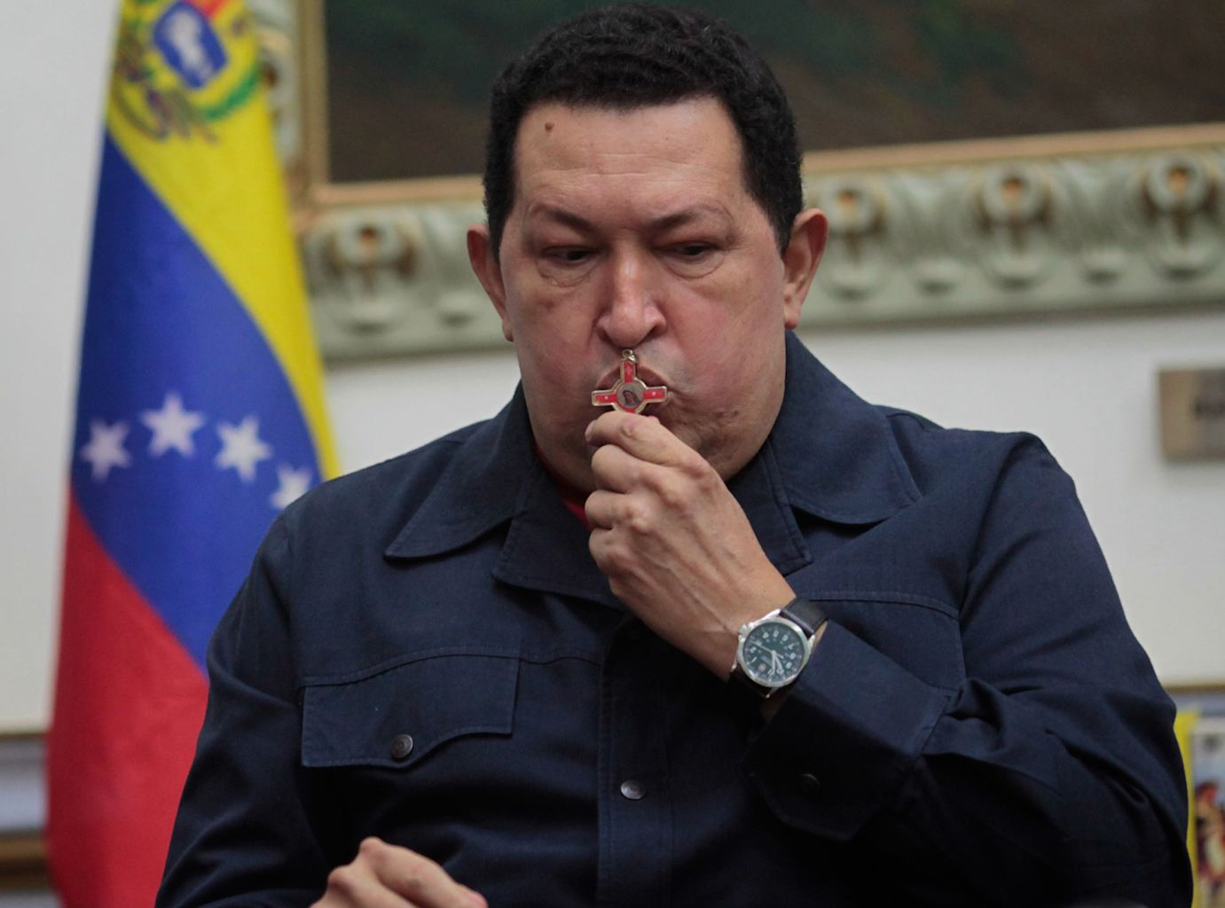 Venezuela's President Hugo Chavez kisses a crucifix during a televised speech form his office at Miraflores Presidential palace in Caracas, Venezuela, Saturday, Dec. 8, 2012.