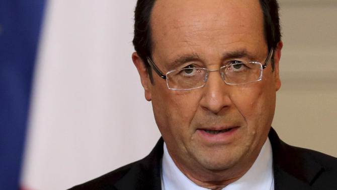 """France's President Francois Hollande delivers a speech on the situation in Mali at the Elysee Palace in Paris, Friday, Jan. 11, 2013. French forces began backing Malian soldiers Friday in their fight against radical Islamists, drawing the former colonial power into a military operation to oust the al-Qaida-linked militants nine months after they seized control of northern Mali.  French President Francois Hollande said  that the operation would last """"as long as necessary"""" and said it was aimed notably at protecting the 6,000 French citizens in Mali. Kidnappers currently hold seven French hostages in the country.  (AP Photo/Philippe Wojazer, Pool)"""