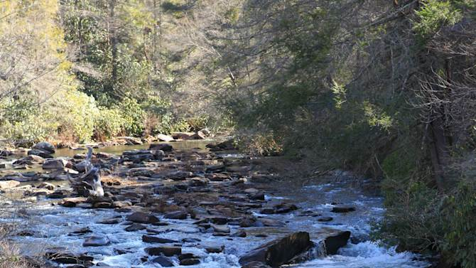 """This undated image provided by VisitNC.com shows the bottom of Triple Falls at DuPont State Recreational Forest in North Carolina, which was used as a backdrop for arena scenes in """"The Hunger Games."""" The movie was filmed entirely in North Carolina, which is gearing up for tourism from fans. (AP Photo/VisitNC.com, Bill Russ)"""